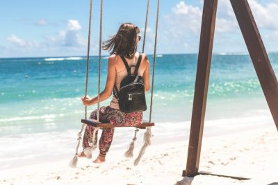 woman on a beach swing