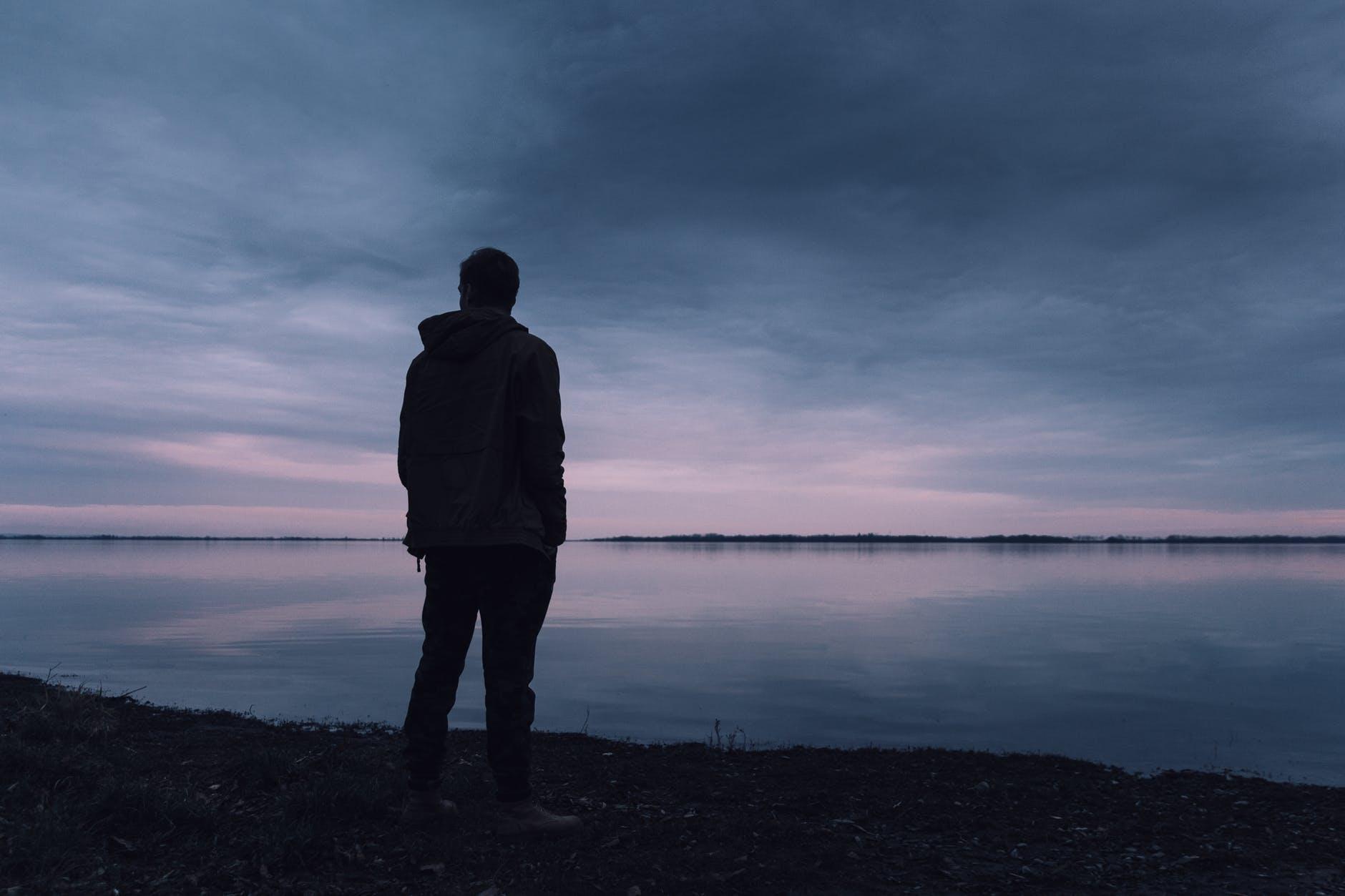 man gazing at sunset