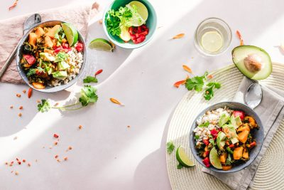 healthy foods in bowls on table with table cloth