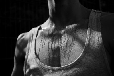 a woman's neck and chest sweating