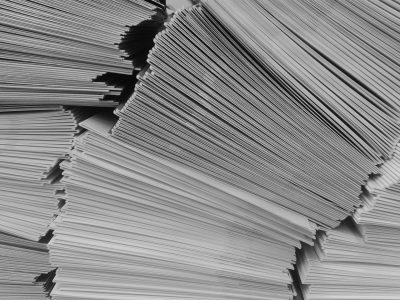 pile of papers tilting over