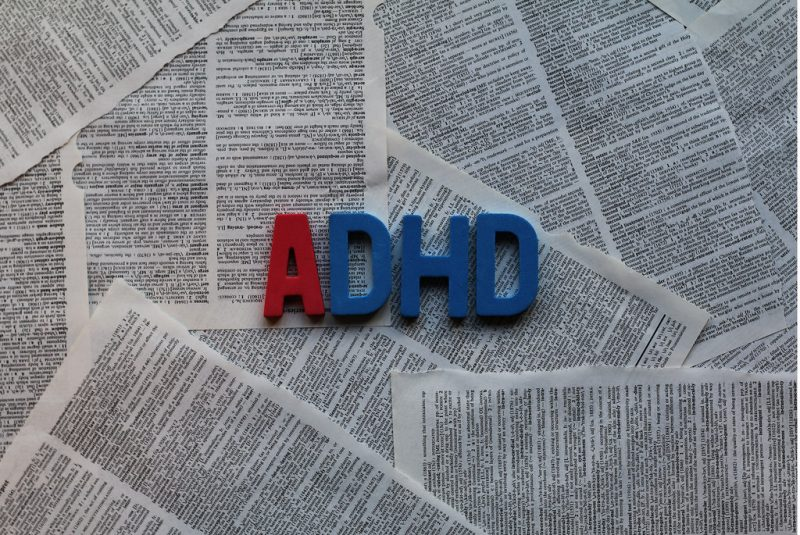 ADHD word on mess of papers