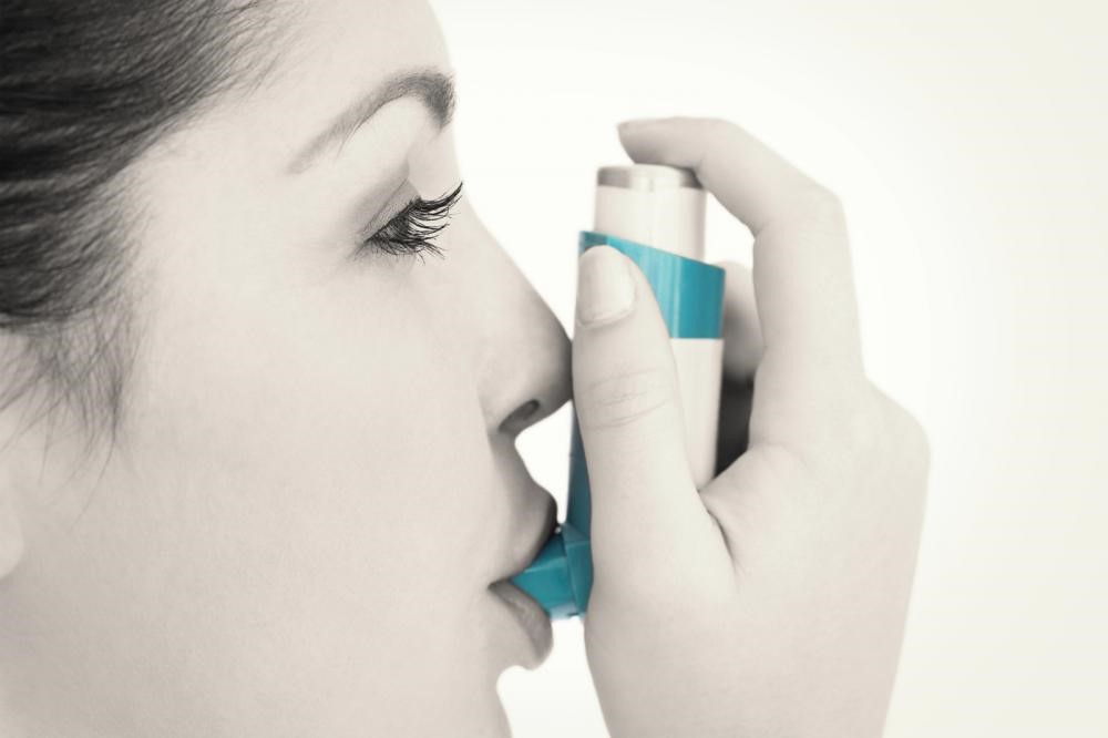 An image of a woman with an inhaler