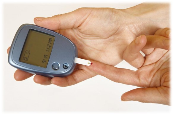 person self testing diabetes insulin finger prick